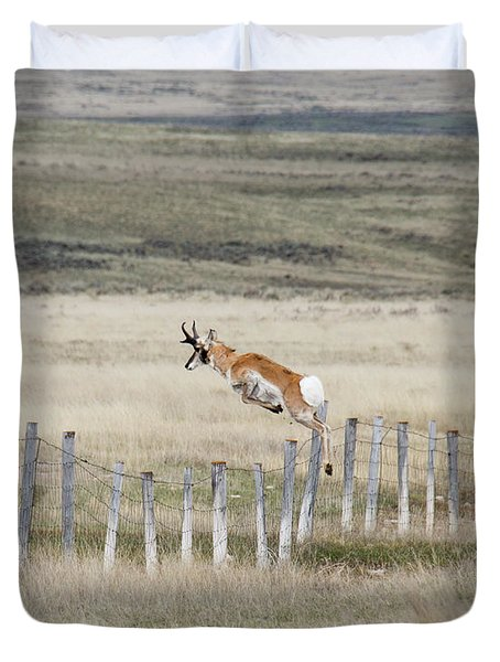 Duvet Cover featuring the photograph Antelope Jumping Fence 2 by Rebecca Margraf