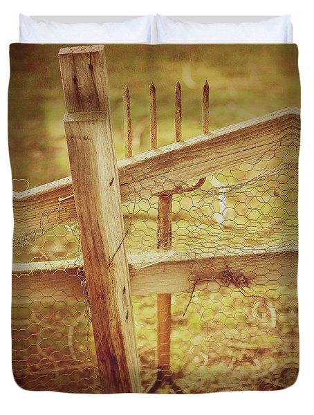 Spading Fork On Chicken Wire Fence Morning Sunlight Duvet Cover
