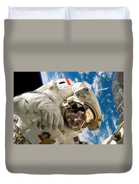 Duvet Cover featuring the pyrography Astronaut During The Third Spacewalk Of Sts-121 by Artistic Panda