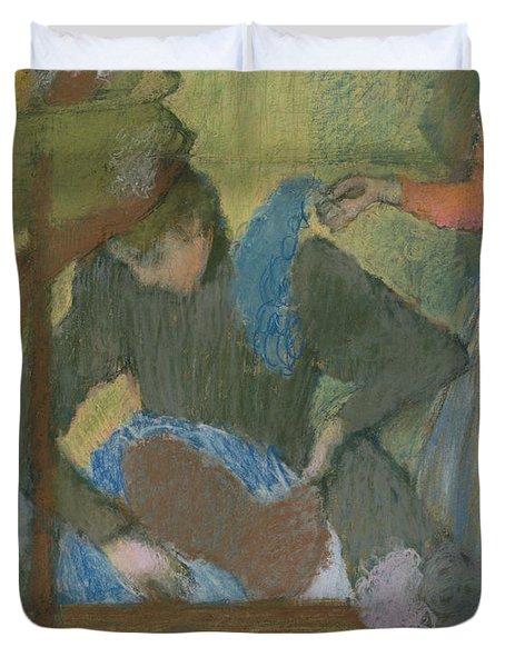 At The Hat Maker Duvet Cover by Edgar Degas