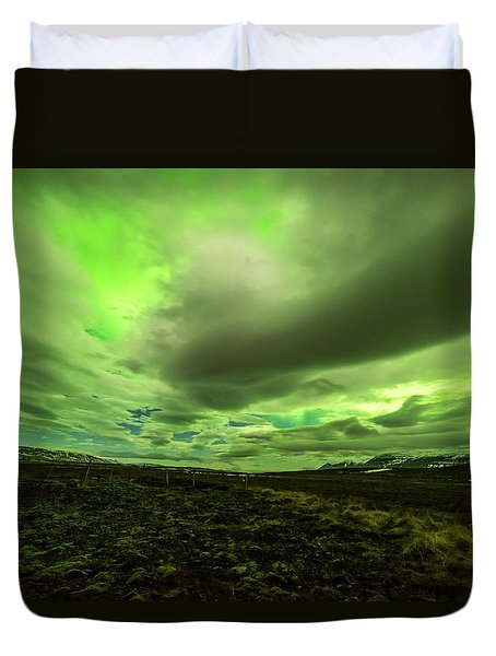 Aurora Borealis Over A Frozen Lake Duvet Cover by Joe Belanger
