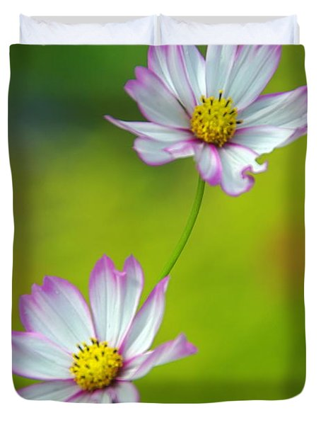 Duvet Cover featuring the photograph Autumn Flowers by Byron Varvarigos
