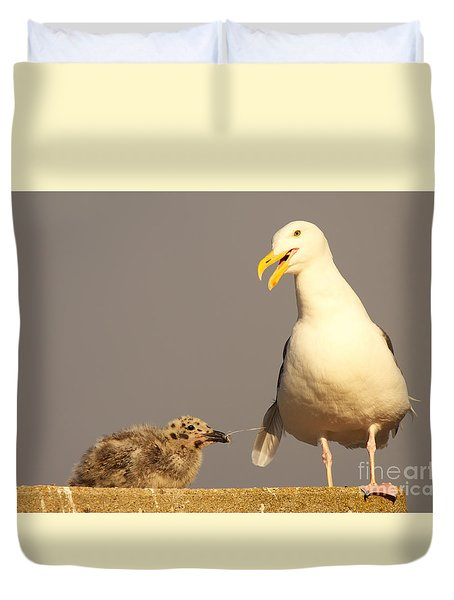Duvet Cover featuring the photograph Baby Pulling On Mother's Tail by Max Allen