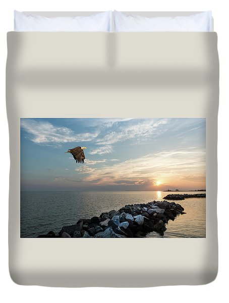 Bald Eagle Flying Over A Jetty At Sunset Duvet Cover