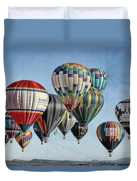 Duvet Cover featuring the photograph Ballooning by Marie Leslie