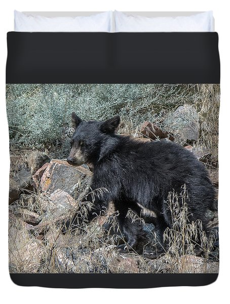 Duvet Cover featuring the photograph Bear Cub Walking by Stephen  Johnson