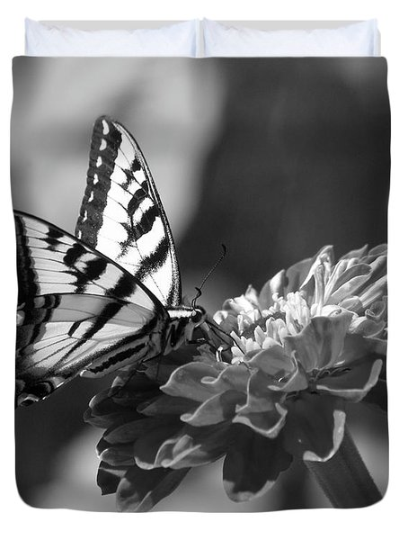 Black And White Butterfly On Zinnia Duvet Cover by Jim And Emily Bush