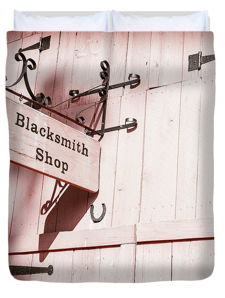 Duvet Cover featuring the photograph Blacksmith Shop by Alexey Stiop
