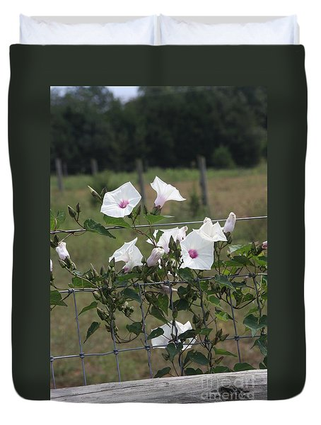 Blooming Fence Duvet Cover by Wendy Coulson