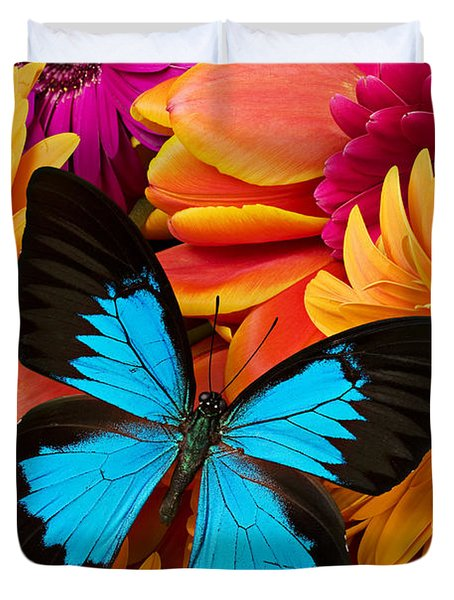 Blue Butterfly On Brightly Colored Flowers Duvet Cover