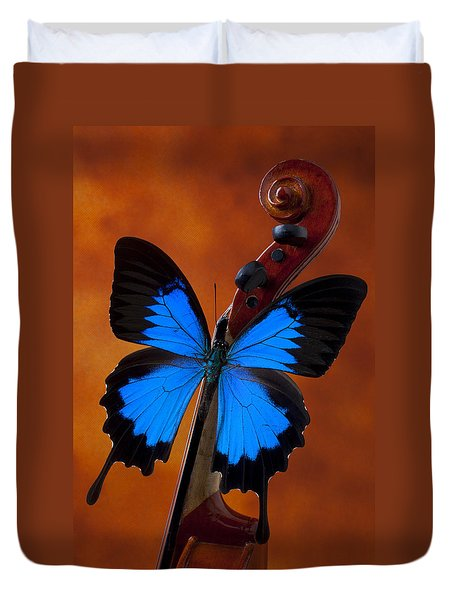Blue Butterfly On Violin Duvet Cover by Garry Gay