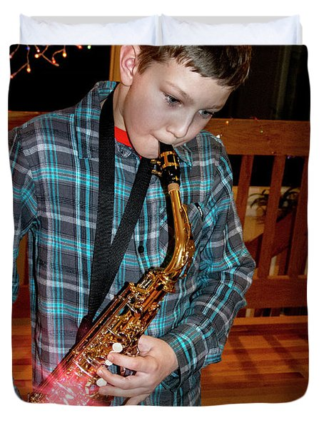 Boy Playing The Saxophone Duvet Cover