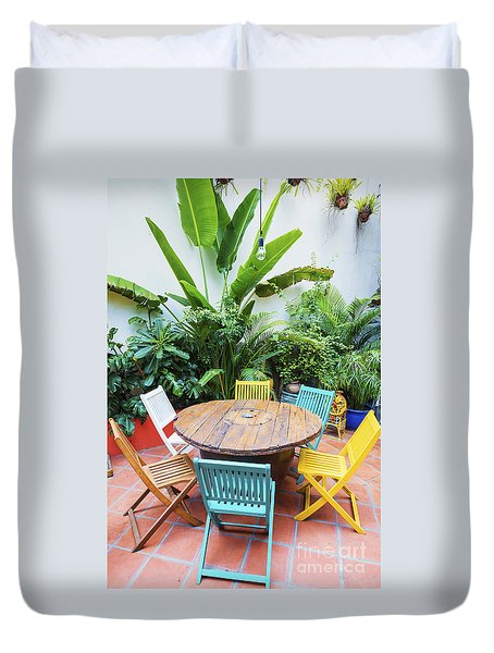 Brightly Coloured Wooden Chairs And Table In Garden Duvet Cover