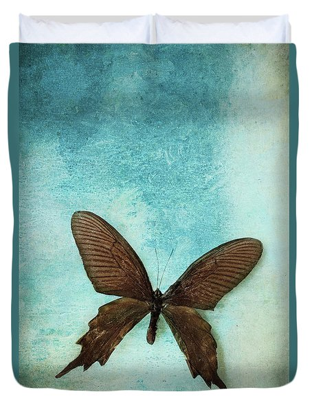 Brown Butterfly Over Blue Textured Background Duvet Cover