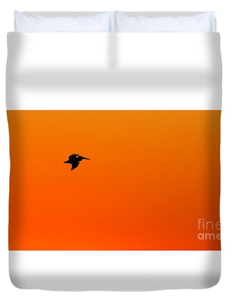 Duvet Cover featuring the photograph Brown Pelican Flying Against Dawn by Max Allen