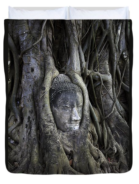 Buddha Head In Tree Duvet Cover by Adrian Evans