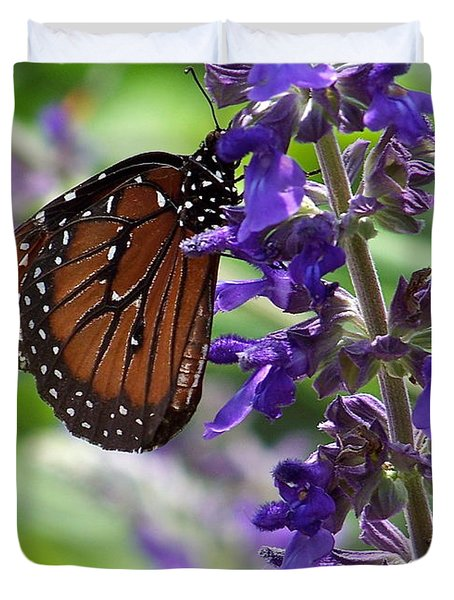 Duvet Cover featuring the photograph Butterfly And Purple Flowers by Carol  Bradley