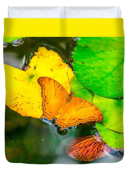 Duvet Cover featuring the photograph Butterfly On Lilies by Jerry Cahill