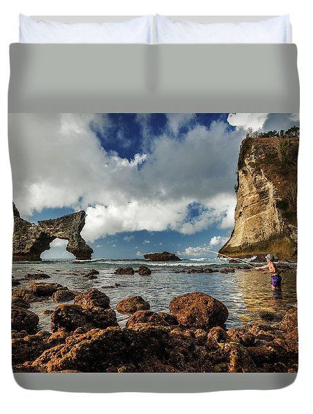 Duvet Cover featuring the photograph catching fish in Atuh beach by Pradeep Raja Prints