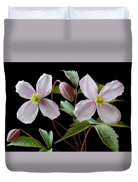 Duvet Cover featuring the photograph Clematis Montana Rubens by Terence Davis