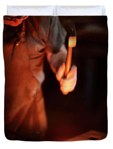 Close-up Of  Blacksmith Forging Hot Iron Duvet Cover