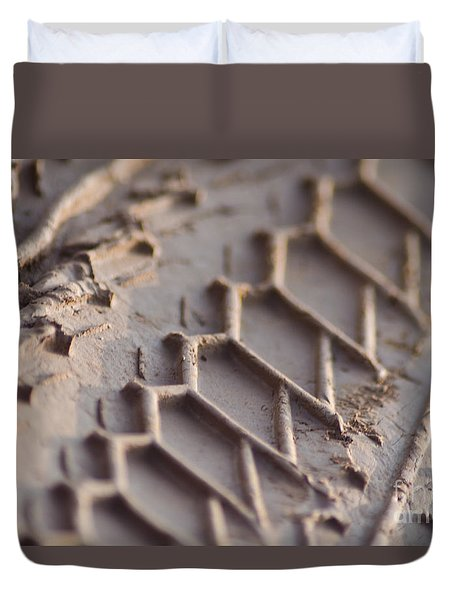 Duvet Cover featuring the photograph Close Up Of Motorcycle Tread Pattern On Muddy Trail by Jason Rosette