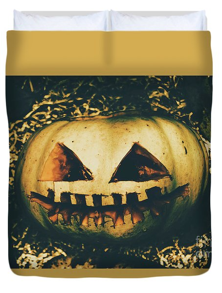 Closeup Of Halloween Pumpkin With Scary Face Duvet Cover