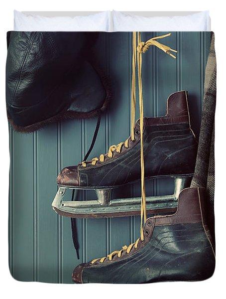 Closeup Of Old Skates On Hooks Duvet Cover