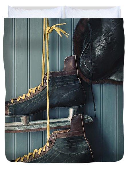 Closeup Of Vintage Men's Skates And Hat On Hooks Duvet Cover