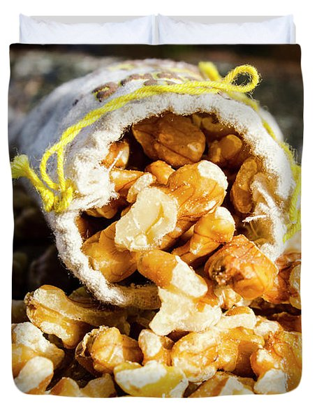 Closeup Of Walnuts Spilling From Small Bag Duvet Cover