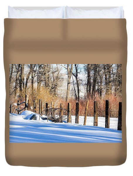 Duvet Cover featuring the photograph Colorado Winter Snow Scene With Old Farming Rake And Rustic Fence by Nadja Rider