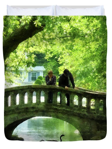 Couple On Bridge In Park Duvet Cover by Susan Savad