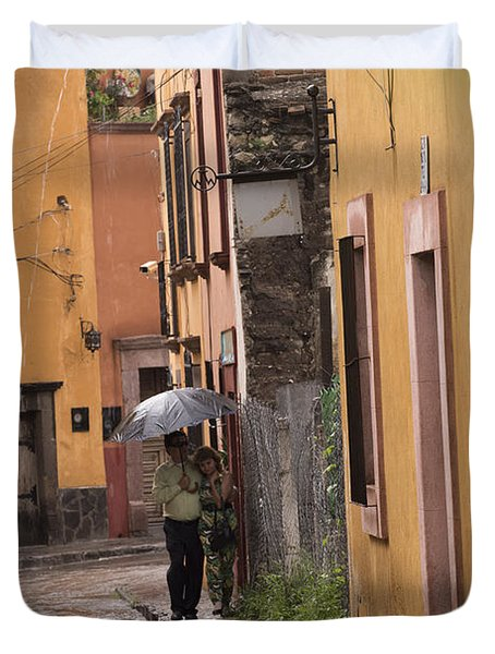 Couple Walking In The Rain Through Old San Miguel Mexico Duvet Cover