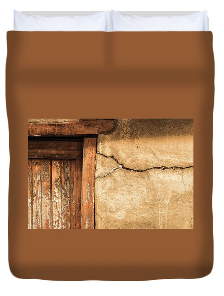 Duvet Cover featuring the photograph Cracked Lime Stone Wall And Detail Of An Old Wooden Door by Semmick Photo