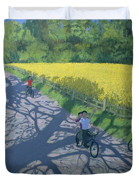 Cyclists And Yellow Field Duvet Cover by Andrew Macara