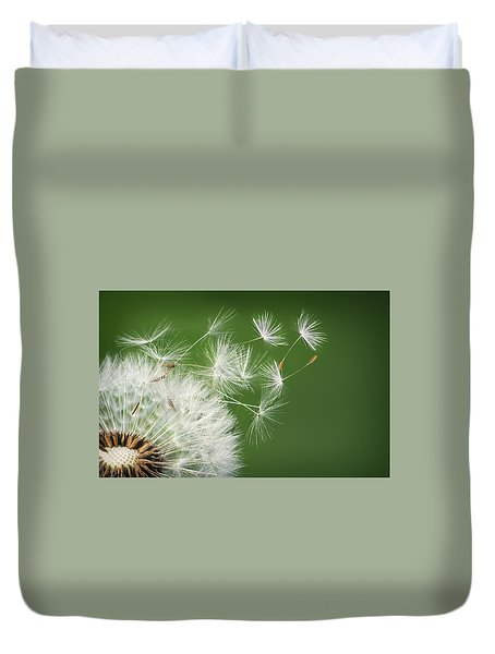 Duvet Cover featuring the photograph Dandelion Blowing by Bess Hamiti