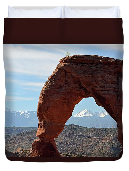 Duvet Cover featuring the photograph Delicate Arch With Wispy Clouds by Bruce Gourley
