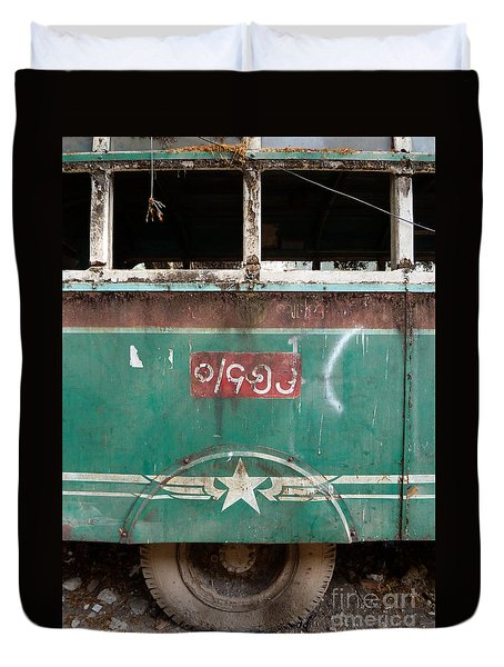 Duvet Cover featuring the photograph Dilapidated Vintage Green Bus In Burma - Side View With Tire by Jason Rosette