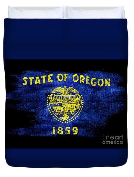 Distressed Oregon Flag On Black Duvet Cover by Jon Neidert