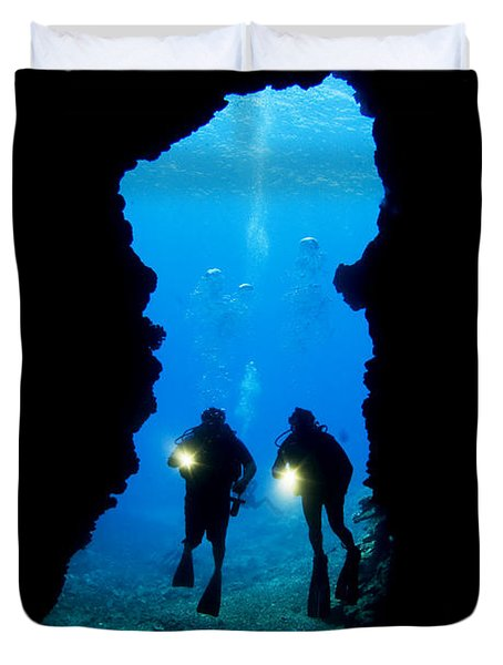 Divers Silhouetted Through Reef Duvet Cover by Dave Fleetham - Printscapes