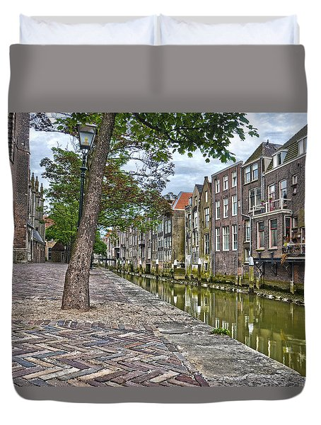 Duvet Cover featuring the photograph Dordrecht Behind The Church by Frans Blok