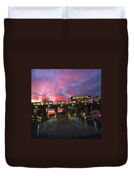 Dramatic Toll Booth Sunrise Duvet Cover by Eugene Evon