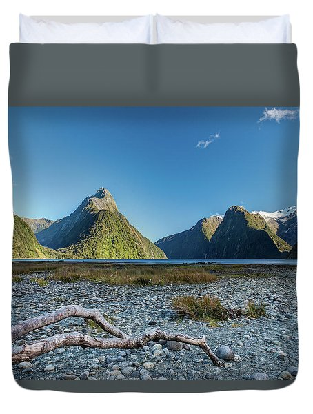 Duvet Cover featuring the photograph Driftwood In Milford Sound by Gary Eason