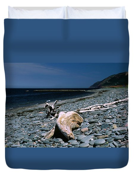 Driftwood On Rocky Beach Duvet Cover by Sally Weigand