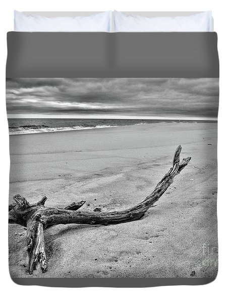 Driftwood On The Beach In Black And White Duvet Cover by Paul Ward