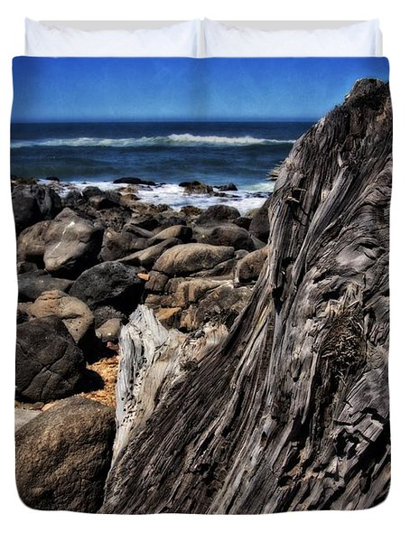 Duvet Cover featuring the photograph Driftwood Rocks Water by Thom Zehrfeld