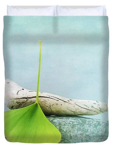 Driftwood Stones And A Gingko Leaf Duvet Cover by Priska Wettstein