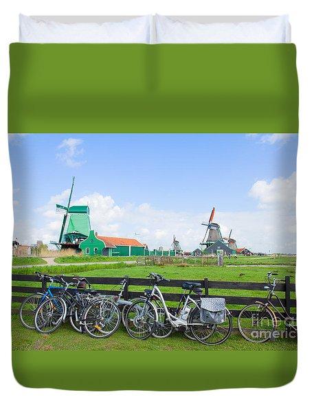 dutch windmills with bikes in Zaanse Schans Duvet Cover
