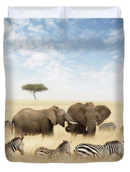 Elephants And Zebras In The Grasslands Of The Masai Mara Duvet Cover