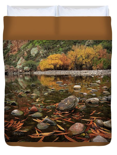 Fallen Leaves Along The River Duvet Cover by Sue Cullumber